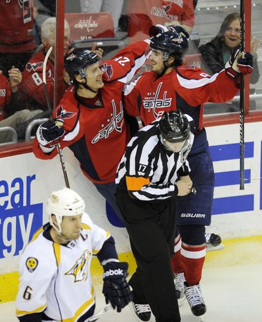 Washington Capitals center Nicklas Backstrom celebrates his goal during the first period against the Nashville Predators on Tuesday, Dec. 20, 2011, in Washington. The Caps won 4-1. (AP Photo/Nick Wass)