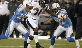FILE - In this Dec. 18, 2011, file photo, Baltimore Ravens wide receiver Anquan Boldin rushes against San Diego Chargers free safety Eric Weddle, right, and Antoine Cason during the first half of a NFL football game in San Diego. Boldin is having surgery on his knee Thursday, Dec. 22 to deal with slightly torn cartilage. (AP Photo/Denis Poroy, File)