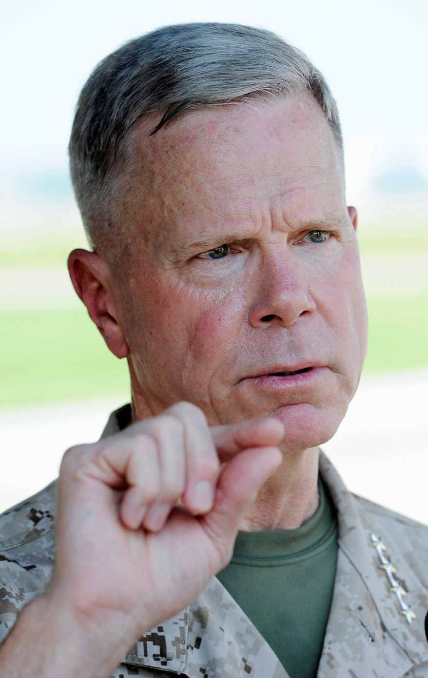 FILE - In this July 29, 2011 file photo, Marine Corps Commandant Gen. James Amos speaks with reporters about the Marine Corps need for the F-35B Joint Strike Fighter, at Patuxent River Naval Air Station, Md. Amos, the U.S. Marines' top general, sprinted up and down the Helmand River Valley in southern Afghanistan on Thursday, Nov. 24, 2011, visiting frontline Marines at nine remote outposts to share Thanksgiving and applaud their gains against the Taliban in a region where al-Qaida hatched the 9/11 plot a decade ago. (AP Photo/Cliff Owen, File)