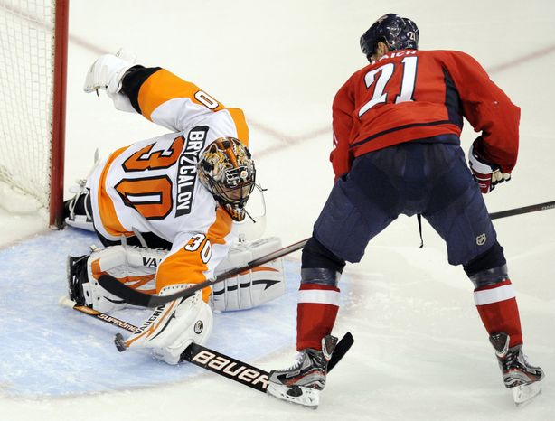 ** FILE ** Philadelphia Flyers goalie Ilya Bryzgalov (30), of Russia, defends the goal against Washington Capitals forward Brooks Laich (21) during the third period of an NHL hockey game, Tuesday, Dec. 13, 2011, in Washington. The Flyers won 5-1. (AP Photo/Nick Wass)