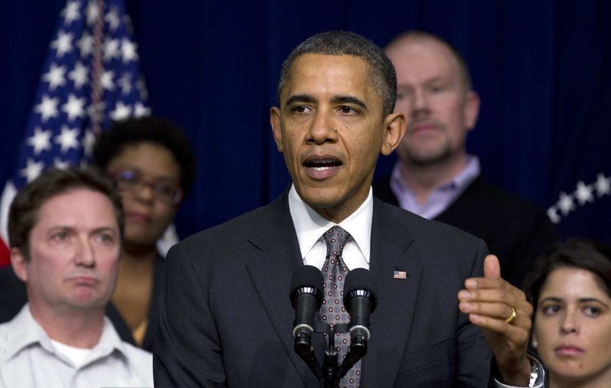 President Barack Obama speaks during a news conference in the South Court Auditorium at the White House complex, Thursday, Dec. 22, 2011, in Washington. The president was flanked at the White House by several people who commented on Twitter about how they would be impacted if the tax cuts were not extended. (AP Photo/Carolyn Kaster)