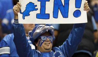 A fan holds a sign for the Detroit Lions making the playoffs in a game against the San Diego Chargers in Detroit, Saturday, Dec. 24, 2011. Detroit won 38-10 to clinch a playoff spot. (AP Photo/Rick Osentoski)