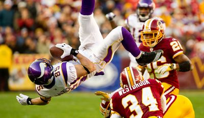 Minnesota Vikings wide receiver Greg Camarillo (85) gets upended while making a 15 yard catch on 3rd down in the second quarter as the Washington Redskins take on the Minnesota Vikings at Fedex Field, Landover, MD, Saturday, December 24, 2011. (Andrew Harnik / The Washington Times)