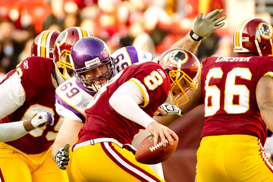 Washington Redskins quarterback Rex Grossman (8) is tackled by Minnesota Vikings defensive end Jared Allen (69) in the second quarter as the Washington Redskins take on the Minnesota Vikings at Fedex Field, Landover, Md., Saturday, Dec. 24, 2011. (Andrew Harnik / The Washington Times)