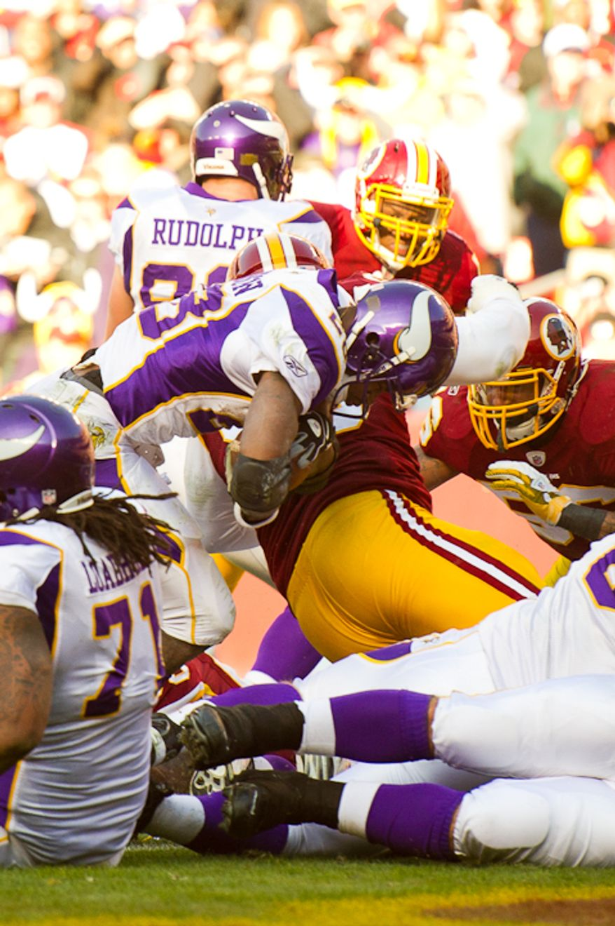 Minnesota Vikings running back Adrian Peterson (28) scores on a 1 yard a touchdown at the start of the second quarter as the Washington Redskins take on the Minnesota Vikings at Fedex Field, Landover, MD, Saturday, December 24, 2011. (Andrew Harnik / The Washington Times)
