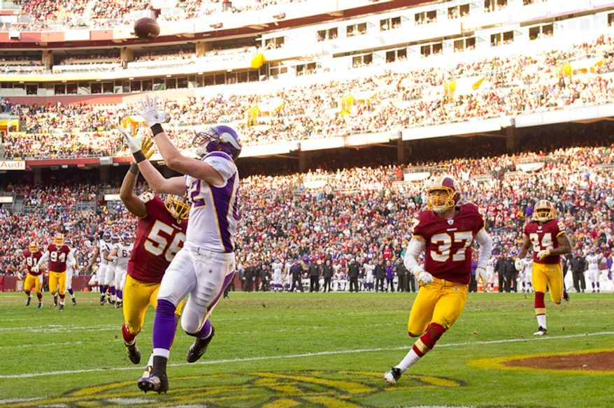 Minnesota Vikings tight end Kyle Rudolph (82) catches a 17 yard touchdown pass to put Minnesota ahead 23-20 in the third quarter as the Washington Redskins take on the Minnesota Vikings at Fedex Field, Landover, MD, Saturday, December 24, 2011. (Andrew Harnik / The Washington Times)