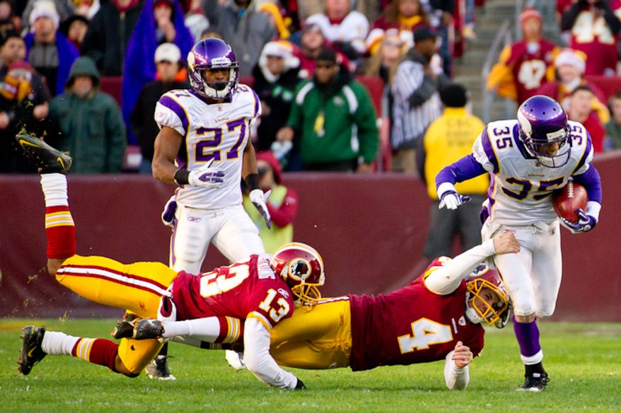 Washington Redskins kicker Graham Gano (4) tackles Minnesota Vikings cornerback Marcus Sherels (35) on a 40 yard kick off return in the fourth quarter as the Washington Redskins take on the Minnesota Vikings at Fedex Field, Landover, MD, Saturday, December 24, 2011. (Andrew Harnik / The Washington Times)