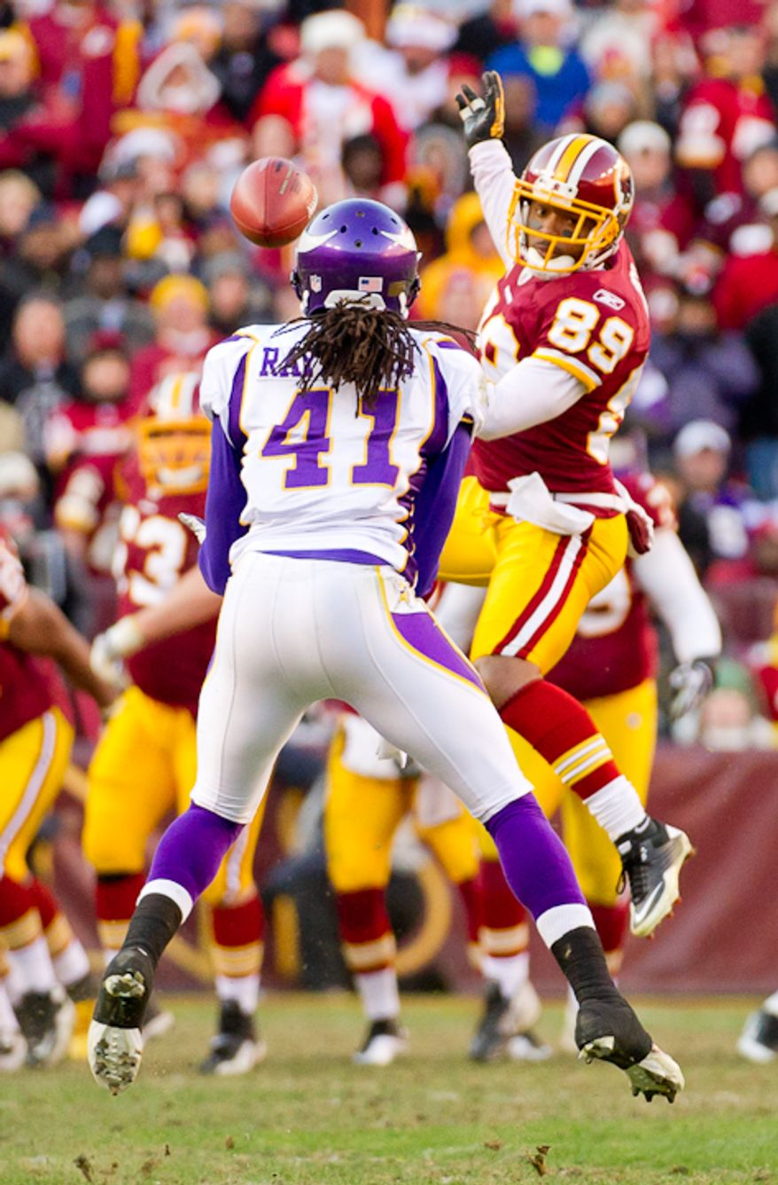 Minnesota Vikings free safety Mistral Raymond (41) intercepts a ball intended for Washington Redskins wide receiver Santana Moss (89) in the fourth period as the Washington Redskins take on the Minnesota Vikings at Fedex Field, Landover, MD, Saturday, December 24, 2011. (Andrew Harnik / The Washington Times)