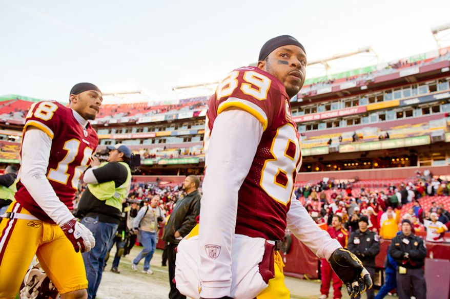 Washington Redskins wide receiver Terrence Austin (18) and Washington Redskins wide receiver Santana Moss (89) leave the field as the Washington Redskins lose to the Minnesota Vikings 33-26 at Fedex Field, Landover, MD, Saturday, December 24, 2011. (Andrew Harnik / The Washington Times)