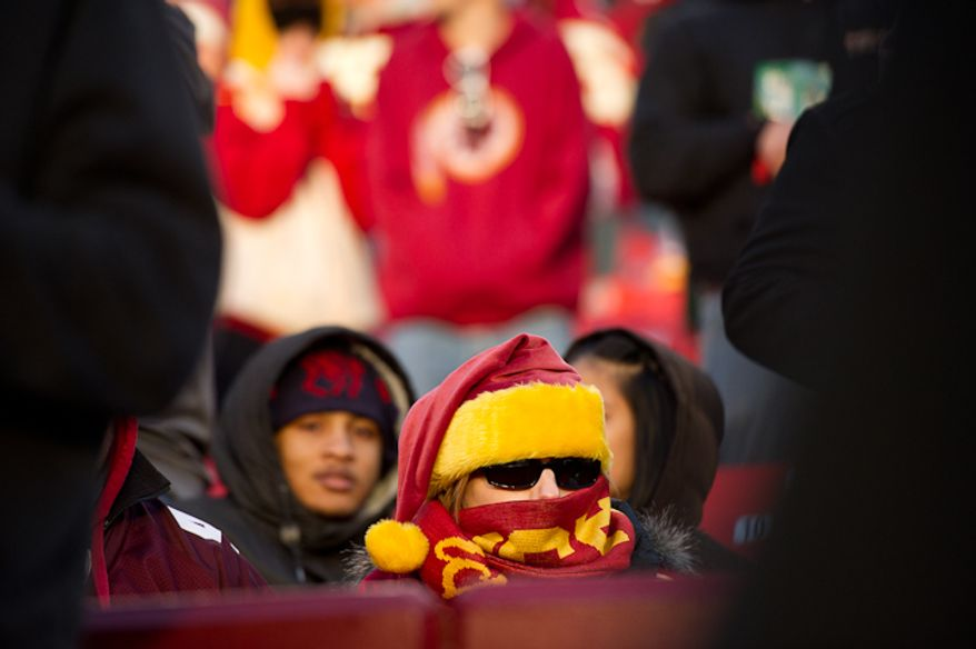 A cold Washington Redskins fan watches as the time ticks down late in the fourth quarter as the Washington Redskins lose to the Minnesota Vikings 33-26 at Fedex Field, Landover, MD, Saturday, December 24, 2011. (Andrew Harnik / The Washington Times)