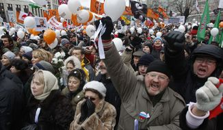 Protesters shout slogans during a protest against alleged vote rigging in Russia's parliamentary elections on Sakharov avenue in Moscow, Russia, Saturday, Dec. 24, 2011. (AP Photo/Misha Japaridze)
