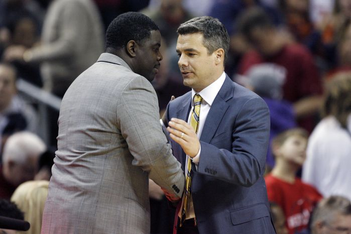 Seattle's Cameron Dollar, left, shakes hands with Virginia's Tony Bennett following a Virginia 83-77 victory over Seattle in an NCAA college basketball game at Key Arena, Wednesday, Dec. 21, 2011, in Seattle. (AP Photo/Joe Nicholson)