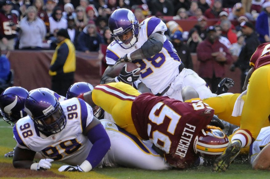 Minnesota Vikings running back Adrian Peterson (28) scores a second quarter touchdown at FedEx Field in Landover, Md., on Saturday, December 24, 2011. (Preston Keres/Special to The Washington Times)