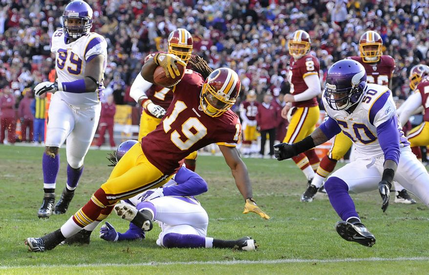Washington Redskins wide receiver Donte' Stallworth (19) spins intor the endzone before Minnesota Vikings outside linebacker Erin Henderson (50) can get to him for a second quarter touchdown at FedEx Field in Landover, Md., on Saturday, December 24, 2011. (Preston Keres/Special to The Washington Times)