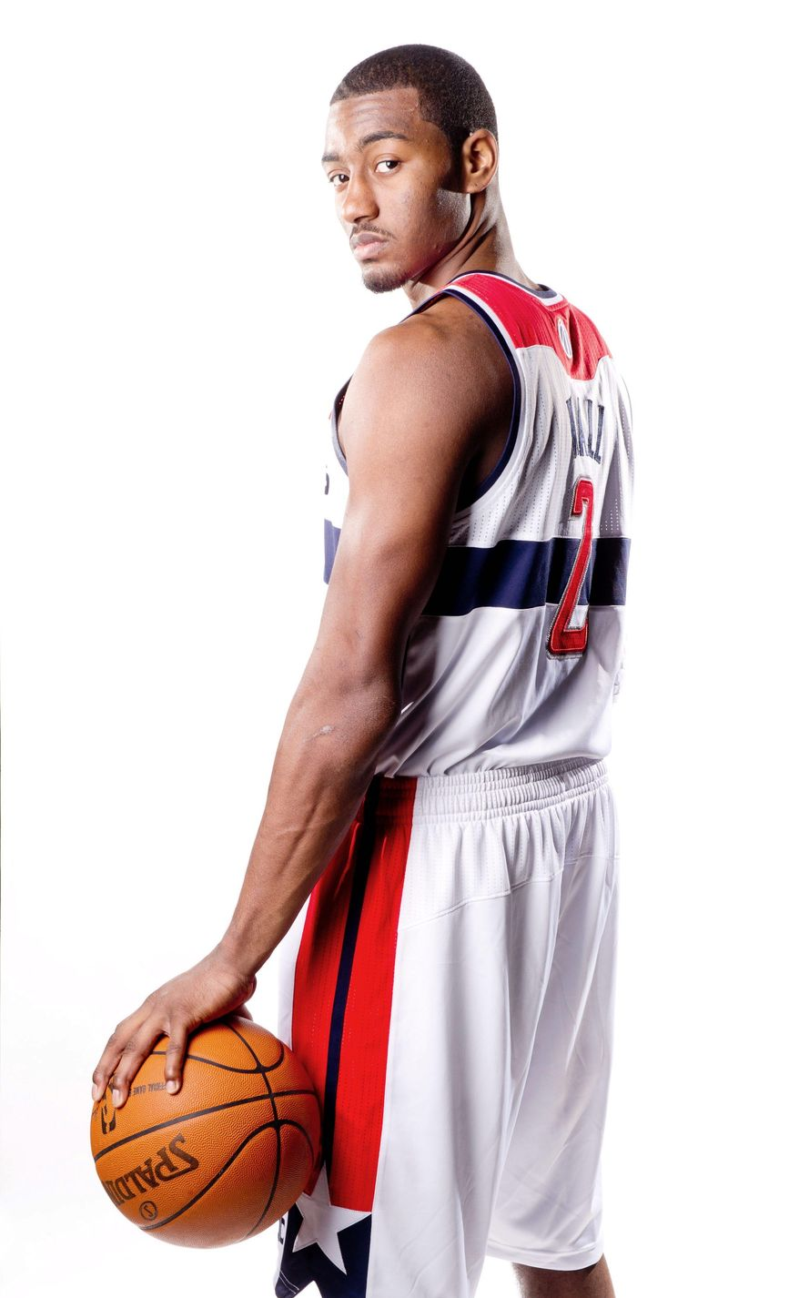 Wizards guard John Wall grew a half-inch in the past year and added muscle to his 6-foot-4 frame. Wall also studies the styles of the NBA's elite point guards with the intent of joining that group. (Andrew Harnik / The Washington Times)