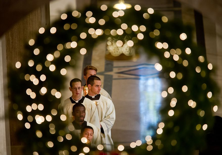 Altar servers wait in the wings as Archbishop of Washington Cardinal Donald Wuerl celebrates Christmas Mass held at the Basilica of the National Shrine of the Immaculate Conception on Christmas Day, Washington, D.C., Sunday, Dec. 25, 2011. (Andrew Harnik/The Washington Times)