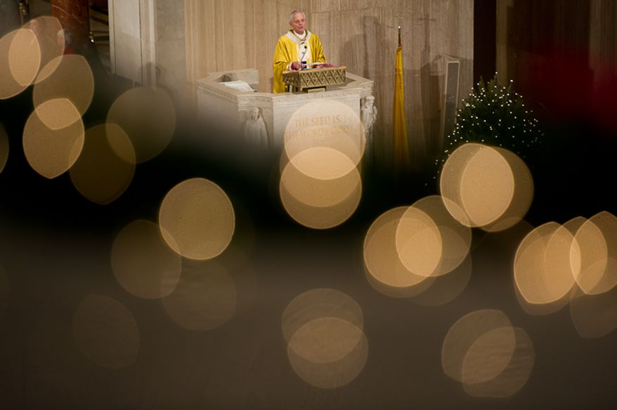 Archbishop of Washington Cardinal Donald Wuerl speaks to worshippers at Christmas Mass held at the Basilica of the National Shrine of the Immaculate Conception on Christmas Day, Washington, D.C., Sunday, Dec. 25, 2011. (Andrew Harnik/The Washington Times)