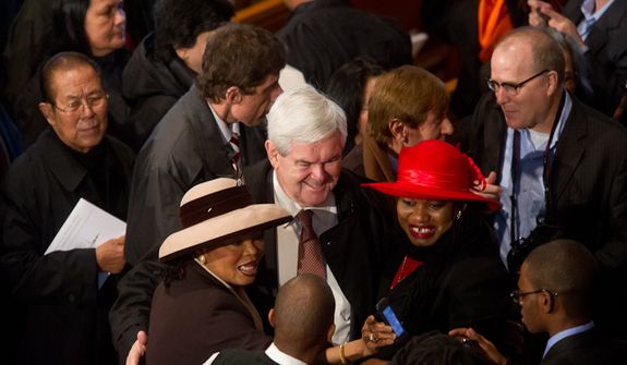 Former Speaker of the House and current Republican presidential candidate Newt Gingrich poses for photos with fellow worshippers following Christmas Mass at the Basilica of the National Shrine of the Immaculate Conception on Christmas Day, Washington, D.C., Sunday, Dec. 25, 2011. (Andrew Harnik/The Washington Times)