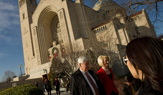 Former Speaker of the House and current Republican presidential candidate Newt Gingrich and his wife Callista Gingrich depart following Christmas Mass at the Basilica of the National Shrine of the Immaculate Conception on Christmas Day, Washington, D.C., Sunday, Dec. 25, 2011. (Andrew Harnik/The Washington Times)