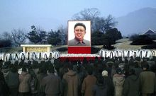 North Koreans pay their respects to the late leader Kim Jong-il in front of his portrait in Chagang, North Korea, on Saturday, Dec. 24, 2011. (AP Photo/Korean Central News Agency via Korea News Service)