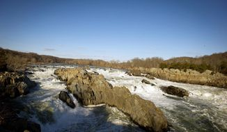 "Backed by the late-afternoon sun, the Potomac River rolls over the rocks at Great Falls. Virginia Gov. Bob McDonnell's two-year state budget does not include thousands in dues for a 71-year-old multistate compact to maintain the river. ""Virginia's membership ... is no longer needed to provide quality management of the state's interest in the river basin,"" says Doug Domenech, the state's secretary of Natural Resources. (Rod Lamkey Jr./The Washington Times)"