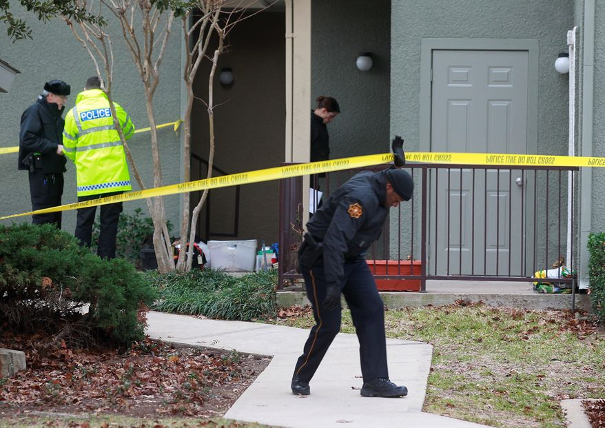 Grapevine, Texas, police investigate the scene of a shooting rampage that left seven people dead Sunday. Four women and three men who police think were related were found fatally shot. Police said they think the shooter is among the dead. (Dallas Morning News via Associated Press)