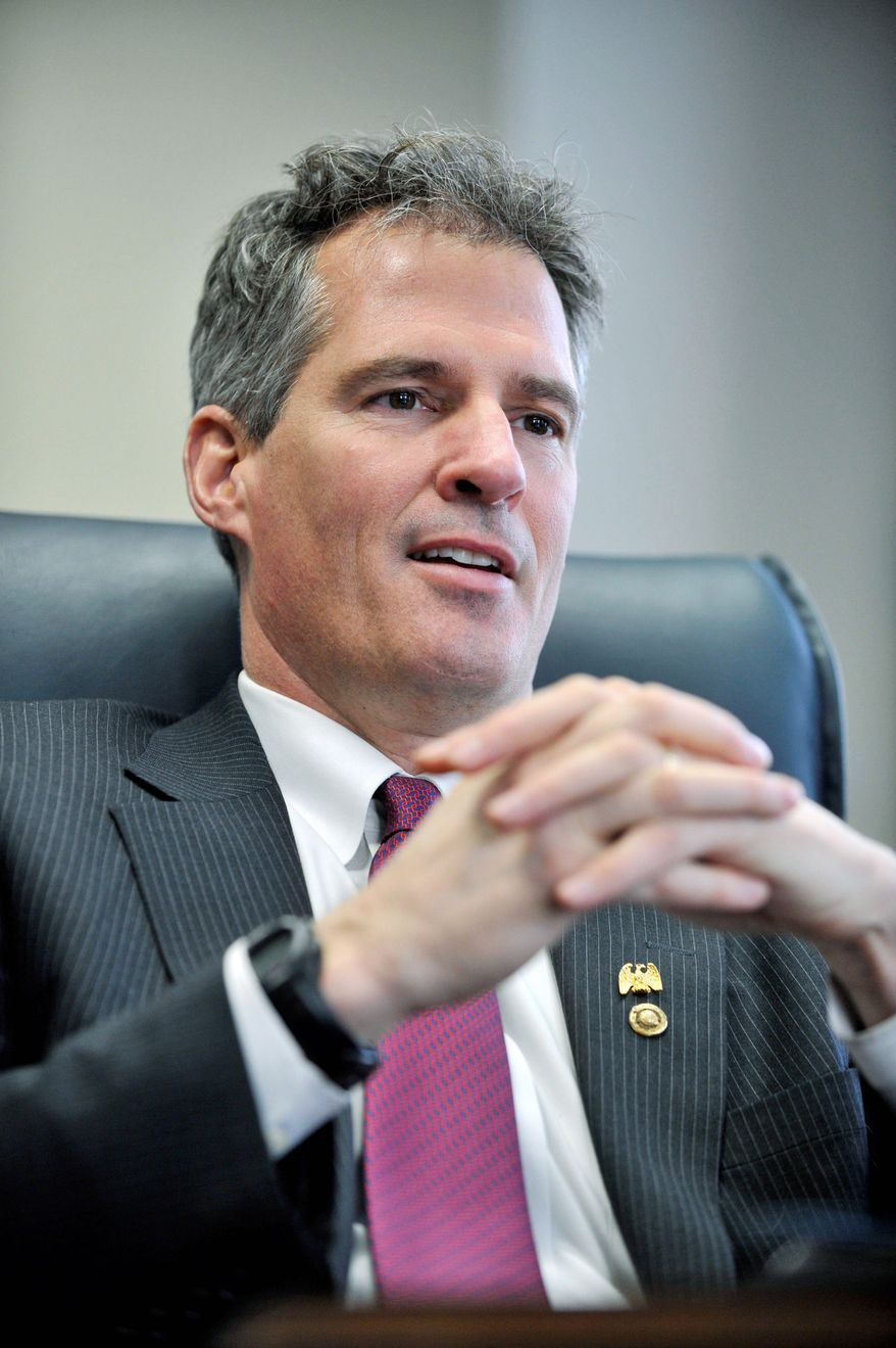 Outside groups on both sides are spending millions of dollars on Massachusetts' high-profile U.S. Senate race between Republican Sen. Scott P. Brown (seen here) and Democratic challenger Elizabeth Warren. The level of spending foreshadows the role such groups will play in many of next fall's big political matchups. (Associated Press)