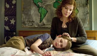 """What a great way to get back on the horse. It was hard, but it was what it's supposed to be,"" actress Sandra Bullock said of her role in ""Extremely Loud & Incredibly Close."" She plays a wife whose husband dies at the World Trade Center in New York on Sept. 11. Thomas Horn, in a scene with Miss Bullock, plays their son. (Warner Bros. Pictures via Associated Press)"