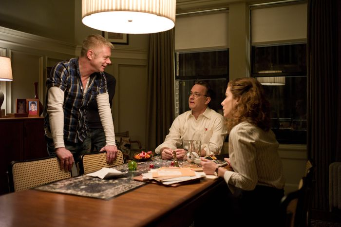 "Director Stephen Daldry (left) talks to Tom Hanks and Sandra Bullock on the set of ""Extremely Loud & Incredibly Close."" The film is based on a novel by Jonathan Safran Foer. (Warner Bros. Pictures via Associated Press)"