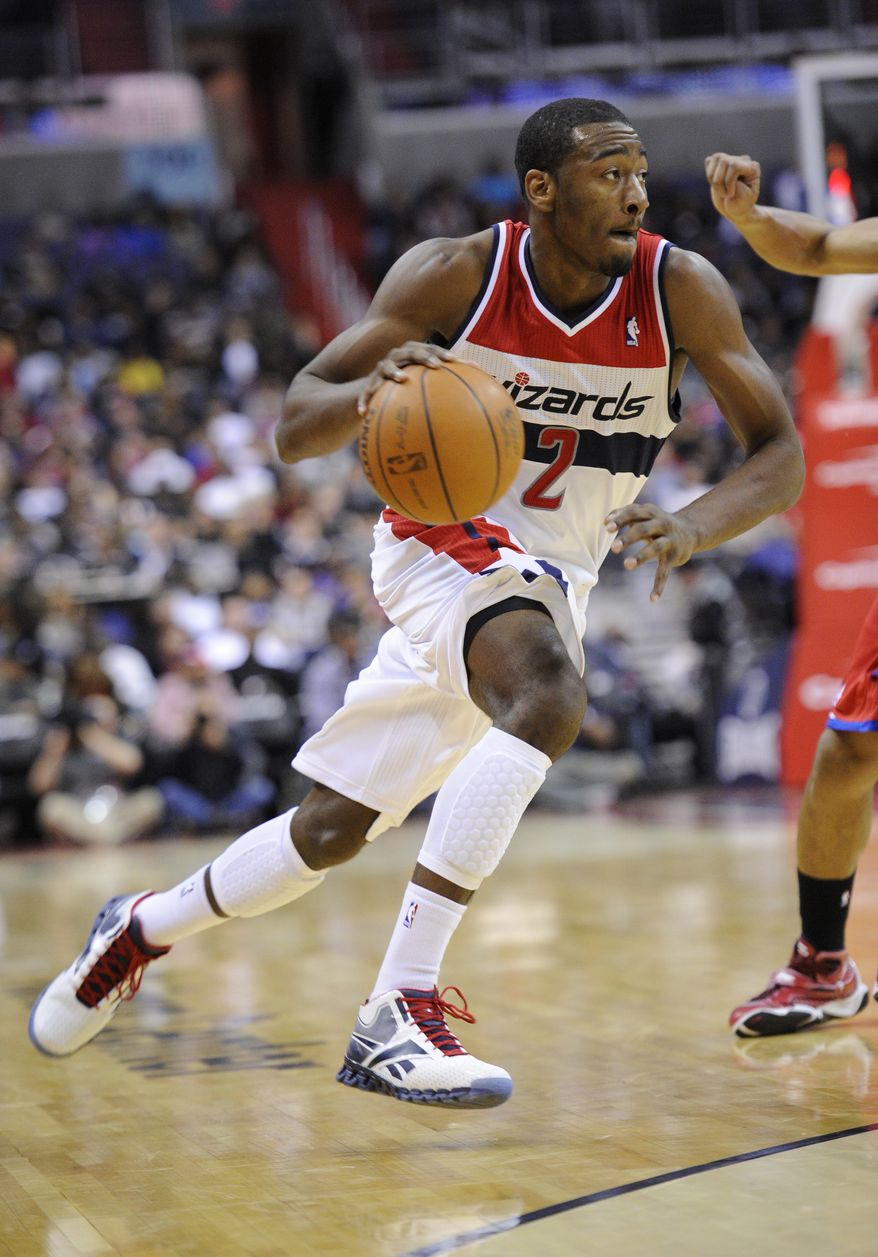 Washington Wizards point guard John Wall (2) dribbles the ball against the Philadelphia 76ers during the second half of an NBA preseason game, Friday, Dec. 16, 2011, in Washington. (AP Photo/Nick Wass)