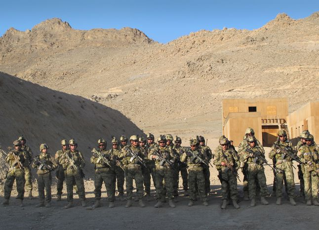 ** FILE ** Members of the growing Afghan special forces stand in formation after conducting a practice raid at a training field on the outskirts of Kabul, Afghanistan, on Thursday, Dec. 15, 2011. (AP Photo/Deb Riechmann)