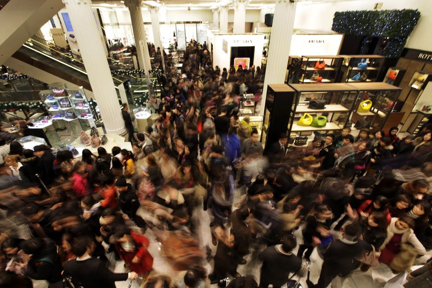 Shoppers rush into a London department store as it opens for Boxing Day sales on Monday, Dec. 26, 2011. (AP Photo/Lefteris Pitarakis)