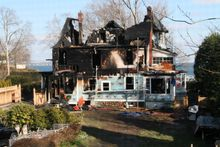 Fire destroyed a Victorian-style house on Long Island Sound in Stamford, Conn., on Sunday, Dec. 25, 2011. Officials said two adults and three children died in the blaze, and two others escaped. (AP Photo/Tina Fineberg)