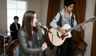 "Siblings Gustavo (left), Angie and Abelardo Vazquez of the Vazquez Sounds posted a cover of Adele's ""Rolling in the Deep"" on YouTube drawing more than 20 million views. (Associated Press)"