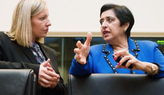 """Foreign Minister Erato Kozakou-Marcoullis (right) said Cyprus """"cannot accept the 200 or 300 thousand settlers who have come illegally to the occupied areas during the last 37 years."""" (Associated Press)"""