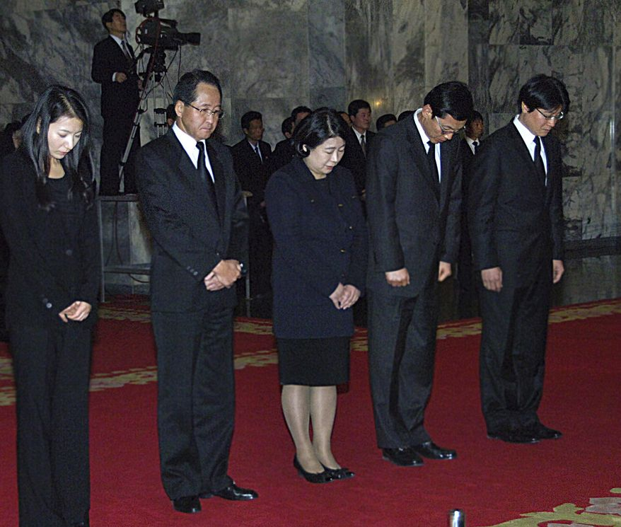 Members of a South Korean mourners delegation, including Hyun Jeong-eun (center), chairwoman of Hyundai Group, pay their respects to the late North Korean leader Kim Jong-il at the Kumsusan Memorial Palace in Pyongyang, North Korea, on Monday, Dec. 26, 2011. (AP Photo)