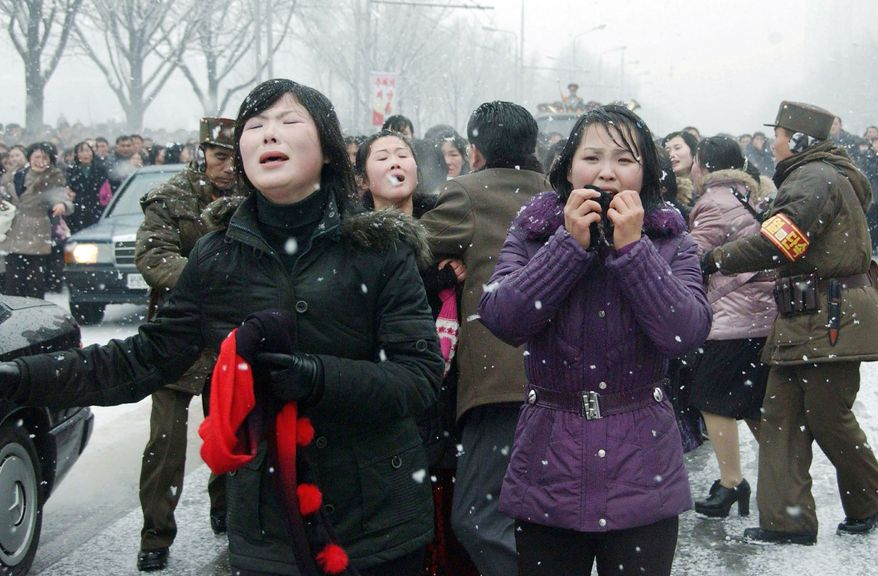 Mourners cry during the funeral procession for late North Korean leader Kim Jong Il, in Pyongyang, North Korea Wednesday, Dec. 28, 2011. (AP Photo/Kyodo News)