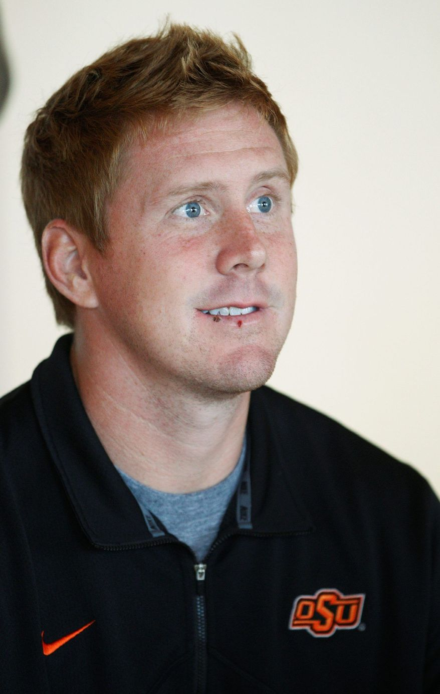 Oklahoma State quarterback Brandon Weeden answers a question during a news conference in Stillwater, Okla., Monday, Nov. 14, 2011. Weeden ranks third in the nation with 363.5 yards passing per game. (AP Photo/Sue Ogrocki)