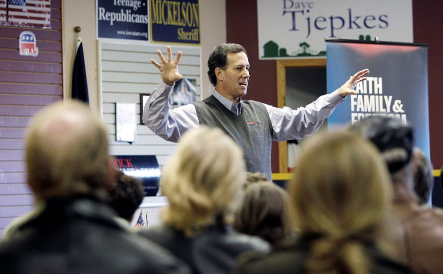 "Former Pennsylvania Sen. Rick Santorum, a Republican presidential candidate, speaks during a town-hall meeting at the Fort Dodge GOP headquarters in Fort Dodge, Iowa, on Tuesday. Mr. Santorum sees ""momentum"" leading up to the caucuses. (Associated Press)"