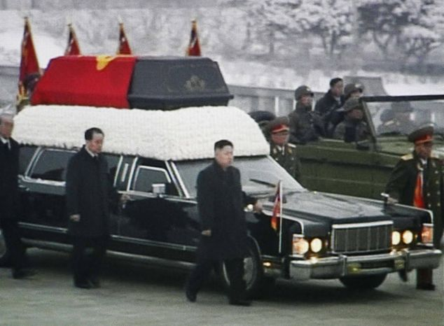 In this image made from KRT video, Kim Jong-un (center), Kim Jong-il's youngest son and successor, walks next to his father's hearse during a funeral procession for the late North Korean leader in Pyongyang, North Korea, on Wednesday, Dec. 28, 2011. (AP Photo/KRT via APTN)