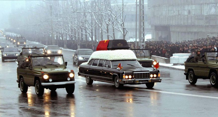 In this Wednesday, Dec. 28, 2011 photo released by the Korean Central News Agency and distributed in Tokyo, Dec. 29, 2011 by the Korea News Service, the hearse carrying late North Korean leader Kim Jong Il is driven past during his funeral procession in Pyongyang, North Korea. (AP Photo/Korean Central News Agency via Korea News Service)
