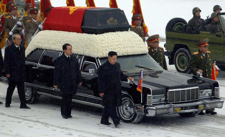 In this Wednesday, Dec. 28, 2011 photo released by the Korean Central News Agency and distributed in Tokyo, Dec. 29, 2011 by the Korea News Service, North Korea's next leader, Kim Jong Un, front right, walks beside the hearse carrying the body of his late father and North Korean leader Kim Jong Il during the funeral procession in Pyongyang, North Korea. Behind Kim Jong Un, in order are Jang Song Thaek, Kim Jong Il's brother-in-law and vice chairman of the Natio
