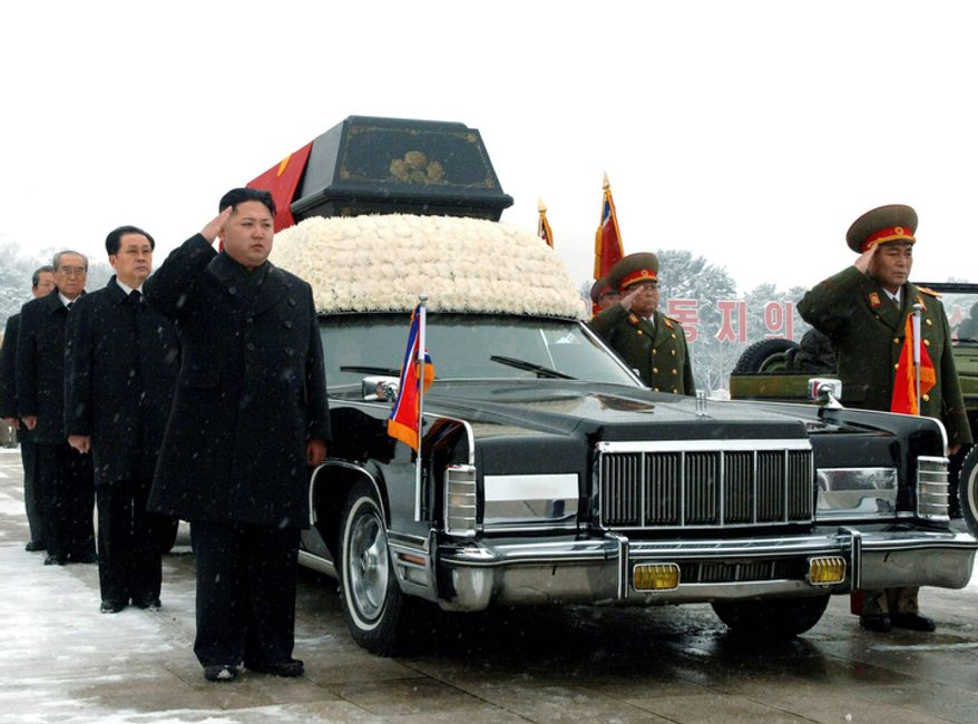 North Korea's next leader, Kim Jong Un, front left, salutes beside the hearse carrying the body of his late father and North Korean leader Kim Jong Il during the funeral procession in Pyongyang, North Korea Wednesday Dec. 28, 2011. Behind Kim Jong Un, in order are Jang Song Thaek, Kim Jong Il's brother-in-law and vice chairman of the National Defense Commission, and Workers Party officials Choe Thae Bok and Kim Ki Nam. At far right is Ri Yong Ho, the Vice Marshal of the Korean People's Army, and behind him is People's Armed Forces Minister Kim Yong Chun.    (AP Photo)