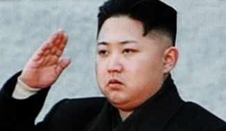 ** FILE ** In this image made from KRT video, Kim Jong-un, North Korean leader Kim Jong-il's youngest son and successor, salutes during the funeral for his father at the end of a procession outside Kumsusan Memorial Palace in Pyongyang, North Korea, on Wednesday, Dec. 28, 2011. (AP Photo/KRT via APTN)