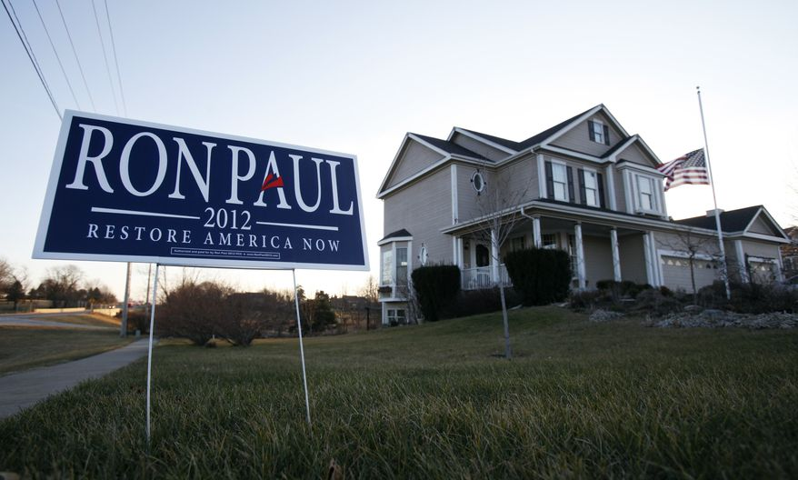 A campaign sign for Republican presidential candidate U.S. Rep. Ron Paul, R-Texas, sits in front of a home, Tuesday, Dec. 27, 2011, in Ankeny, Iowa. (AP Photo/Charlie Neibergall)