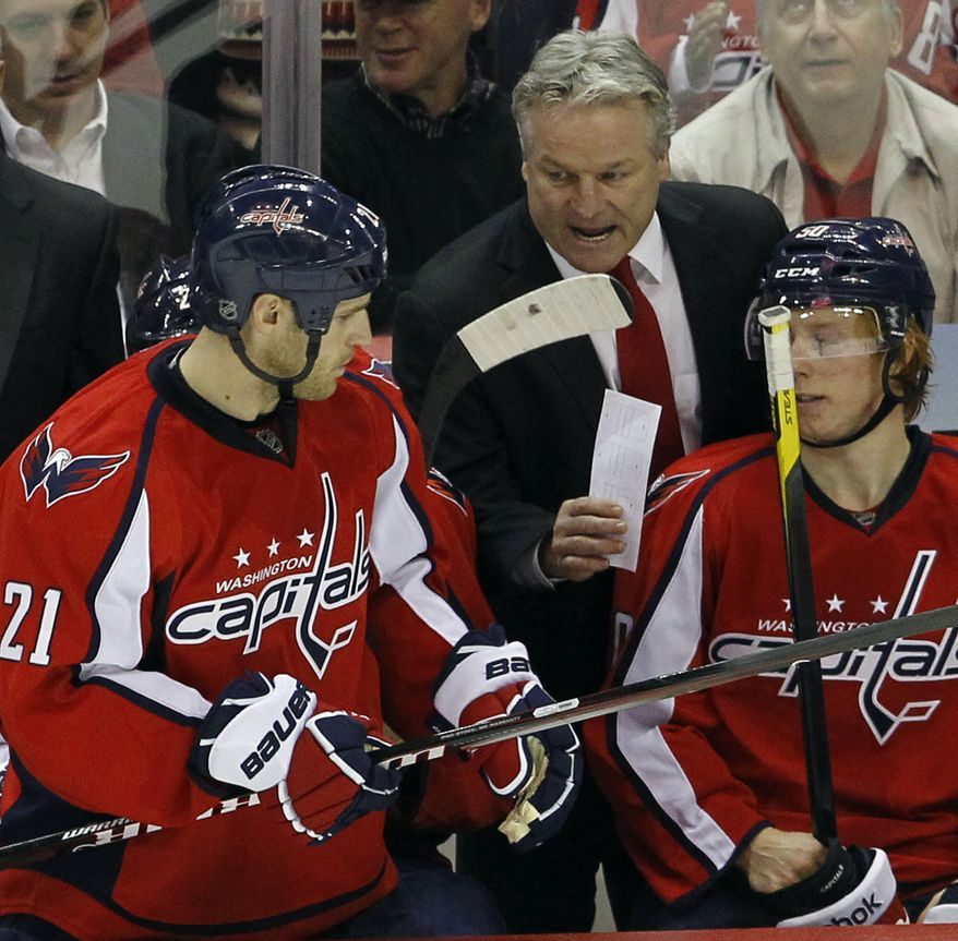The Washington Capitals won just five of their first 12 games since Dale Hunter was named coach on Nov. 29. (AP Photo/Ann Heisenfelt)