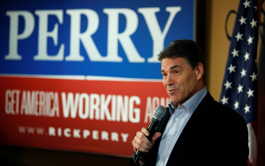 **FILE** Republican presidential hopeful and Texas Gov. Rick Perry speaks Dec. 19, 2011, to local residents during a campaign stop at the Pizza Ranch restaurant in Manchester, Iowa. (Associated Press)