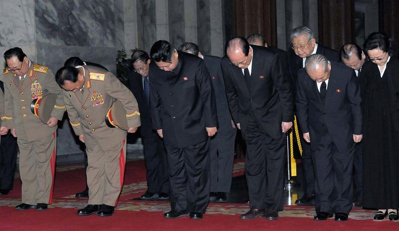 In this Wednesday, Dec. 28, 2011 photo released by the Korean Central News Agency and distributed in Tokyo by the Korea News Service on Thursday, Dec. 29, North Korea's next leader Kim Jong Un, center, with officials, pays respects to late leader Kim Jong Il, during the funeral at Kumsusan Memorial Palace in Pyongyang, North Korea. (AP Photo/Korean Central News Agency via Korea News Service)