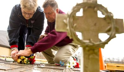 """Bob and Carol Roddy place flowers on the grave of son David, who died in Iraq in 2006. """"After our son was killed, we just wanted a connection, a connection with the young men and women who were still over there,"""" Mrs. Roddy said of Operation Welcome Home Maryland."""