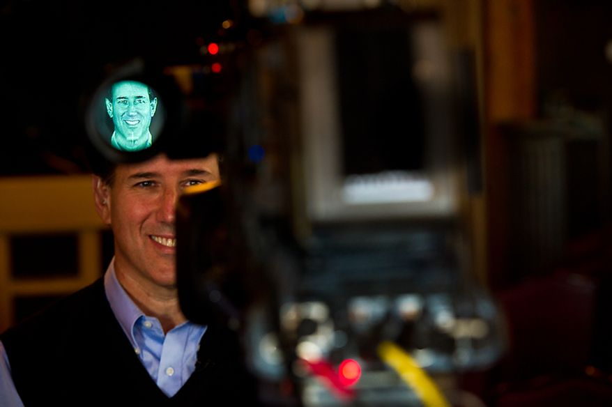 Republican presidential candidate Rick Santorum is interviewed live on CNN following a town hall meeting at the Button Factory Restaurant, Muscatine, IA, Thursday, December 29, 2011. (Andrew Harnik / The Washington Times)